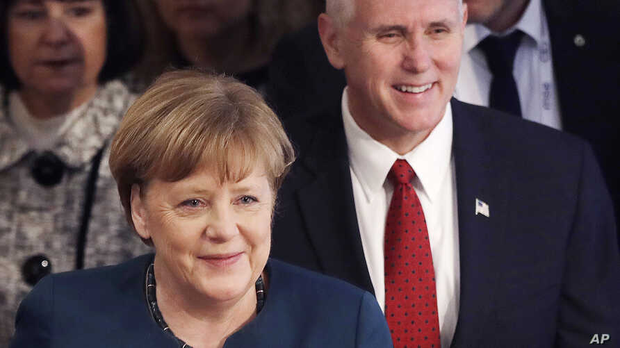 German Chancellor Angela Merkel and United States Vice President Mike Pence arrive at the Munich Security Conference in Munich, Germany, Feb. 18, 2017.