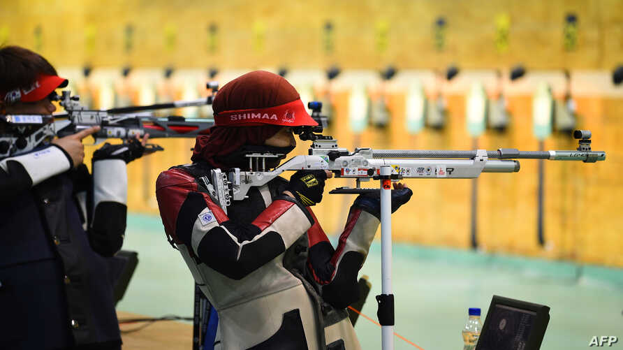 FILE - Shimaa Hashad of Egypt takes part in a pratice session with an air rifle at the International Shooting Sport Federation (ISSF) World Cup at Dr. Karni Singh Shooting Range, in New Delhi, Feb. 20, 2019.