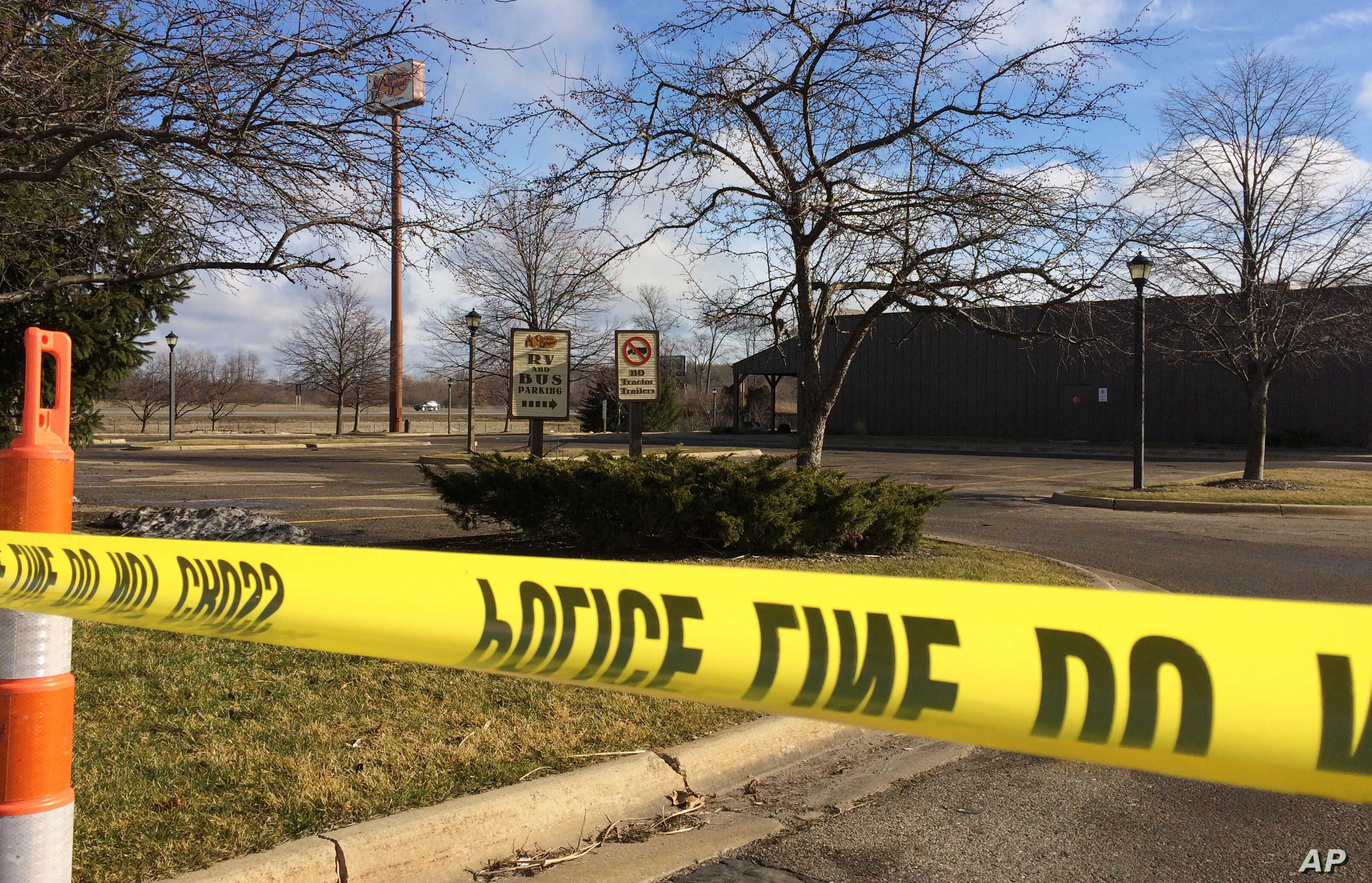 Police tape surrounds the area of a random shooting on Sunday in Kalamazoo, Mich., Feb. 21, 2016.