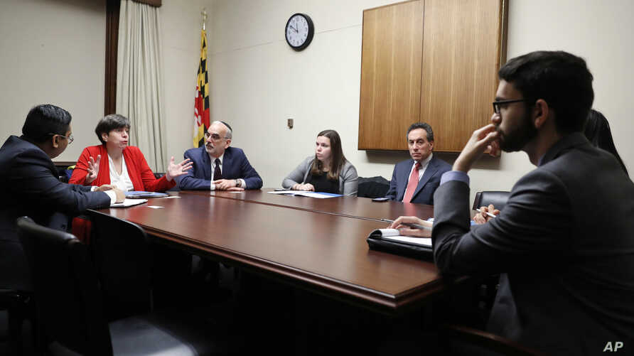 In this Wednesday, Feb. 1, 2017 photo, from left, Eftakhar Alam, with the Washington Islamic Society of North America; Rabbi Julie Schonfeld; Eli Epstein; Belle Yoeli and Ken Bandler, with the American Jewish Committee, meet with staff members from t
