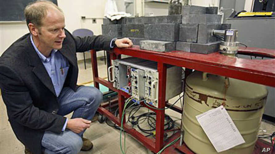 Professor Kai Vetter of the Department of Nuclear Engineering at the University of California at Berkeley kneels beside a germanium detector which is used to identify radioactive airborne particulates in a filter taken from air samples in Berkeley, C