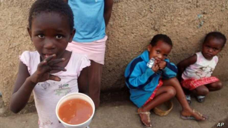 Poor children receive soup and bread from community and religious organizations in Durban, South Africa. (File Photo)