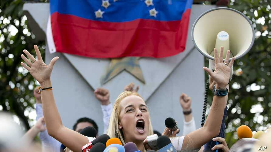Lilian Tintori, wife of jailed opposition leader Leopoldo Lopez, speaks to her husband supporters in Caracas, Venezuela, Sept. 11, 2015.