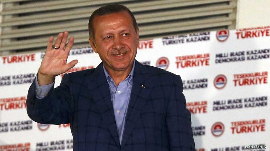 Turkey's Prime Minister Tayyip Erdogan waves to supporters as he celebrates his election victory in front of the party headquarters in Ankara August 10, 2014. Erdogan secured his place in history as Turkey's first directly elected president on Sunday