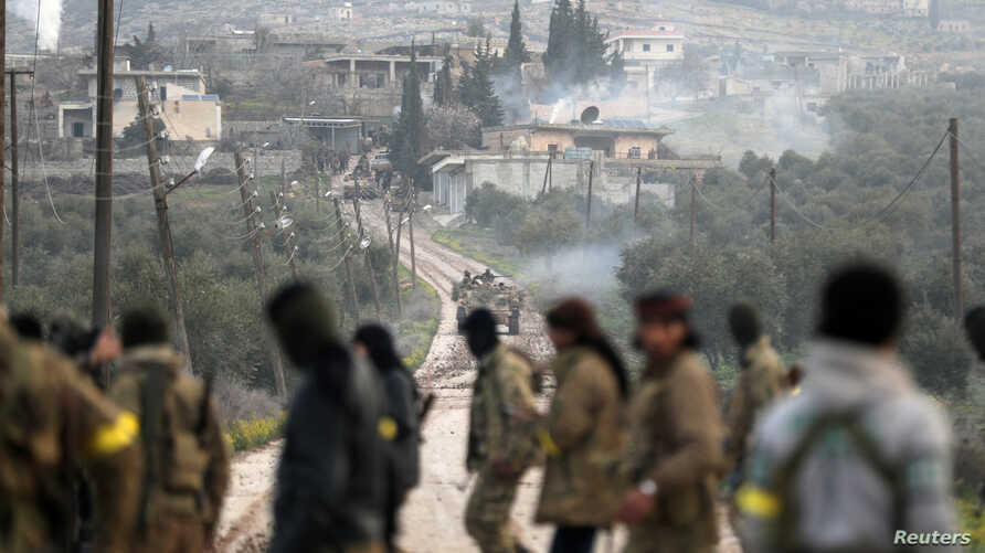 Turkish-backed Free Syrian Army fighters advance in Rajo, Syria, March 3, 2018.