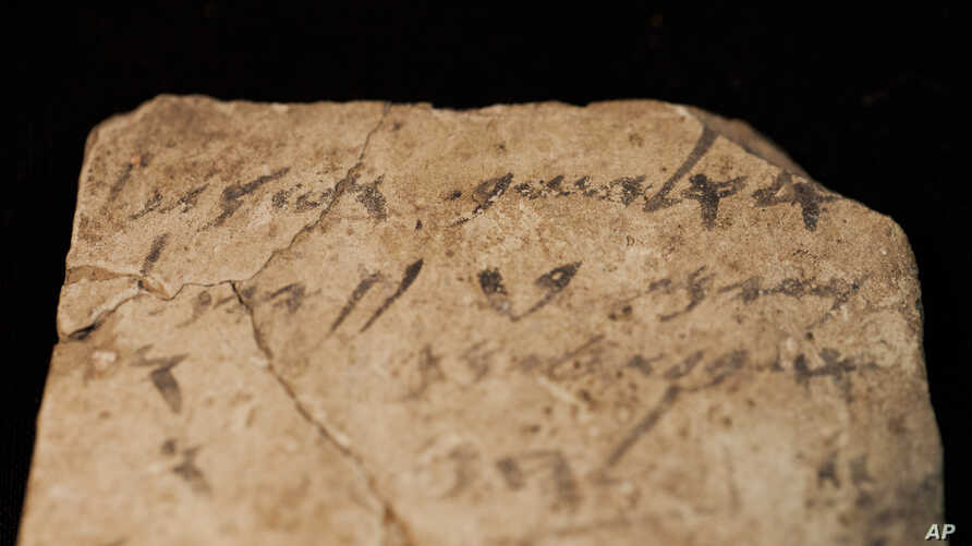 Letters inscribed on pottery, known as ostracons, which were unearthed in an excavation of a fort in Arad, Israel, and dated to about 600 B.C. shortly before Nebuchadnezzar's destruction of Jerusalem, are seen in Israel Museum in Jerusalem on April 1