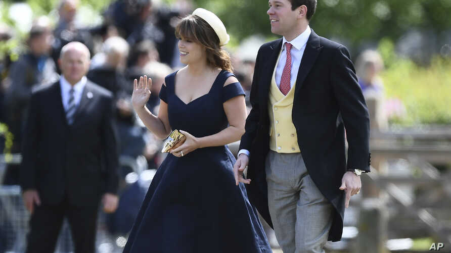 FILE - In this Saturday, May 20, 2017 file photo, Britain's Princess Eugenie and her partner Jack Brooksbank arrive for the wedding of Pippa Middleton and James Matthews at St Mark's Church in Englefield, England. Buckingham Palace says.