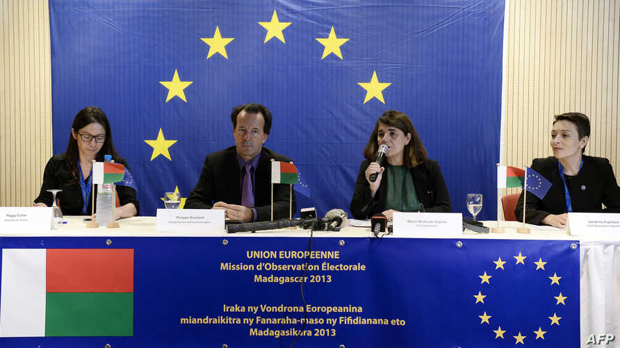 Members of the European Union Election Observation Mission in Madagascar, Peggy Corlin (L), Philippe Boulland (2nd L), Maria Muniz de Urquiza (2nd R), and Sandrine Espinoza, speak to journalists during a press conference concerning election results i