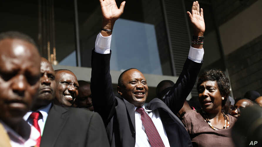 Kenyan president elect Uhuru Kenyatta waves at supporters after winning the elections in Nairobi, Mar. 9, 2013.  Kenya's election commission posted complete results early Saturday showing that Deputy Prime Minister Uhuru Kenyatta prevailed in the cou