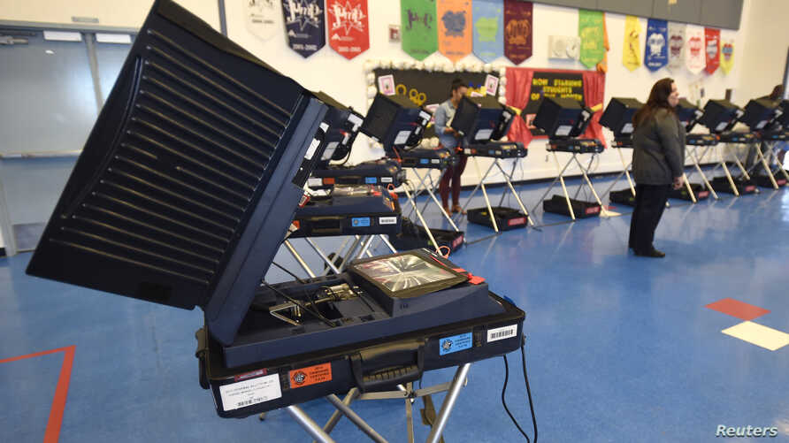 Voting machines are set up for people to cast their ballots during voting in the 2016 presidential election at Manuel J. Cortez Elementary School in Las Vegas, Nevada, Nov. 8, 2016.