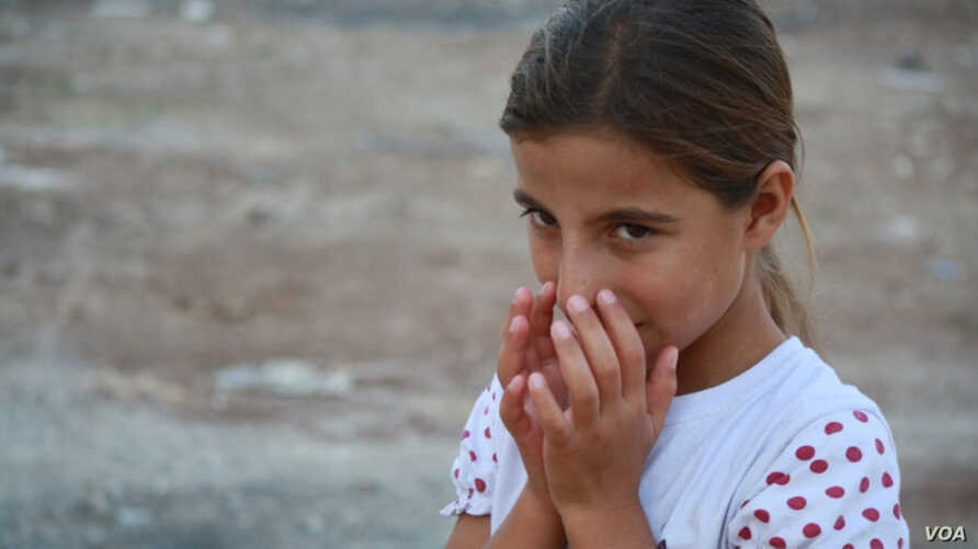 Near Turkey's border with Syria, refugees in camps say newcomers are eager to try their chances at getting into Europe. But some families, like that of 11-year-old Maryam, say after years of war, they prefer the small comforts of the camps. (Credit: