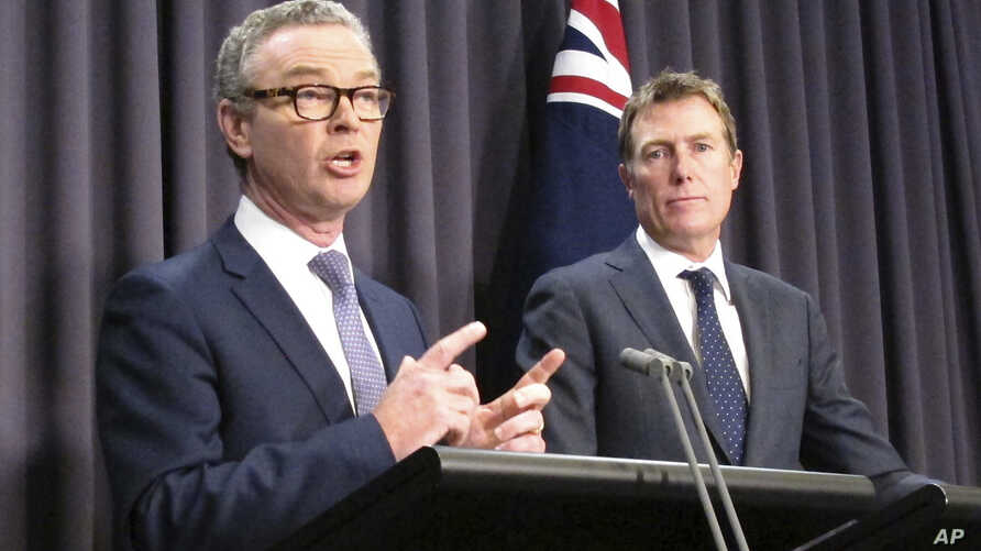 Australian Government Leader in the House of Representatives Christopher Pyne, left, and Attorney-General Christian Porter address reporters in Parliament House in Canberra, May 9, 2018.