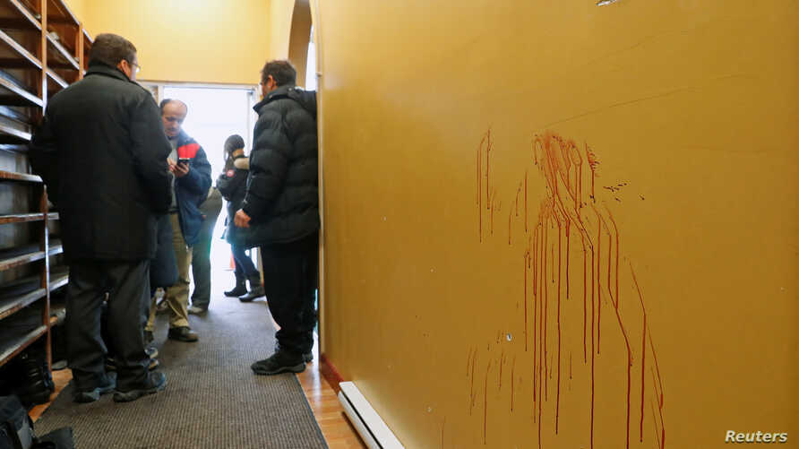 Blood stains are pictured at the Quebec Islamic Cultural Centre in Quebec City, Feb. 1, 2017.