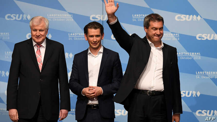 From left, Markus Soeder, Bavaria's State Premier and top candidate of the conservative Christian Social Union party for the regional elections in Bavaria, Austrian Chancellor Sebastian Kurz and German Interior Minister Horst Seehofer take the stage