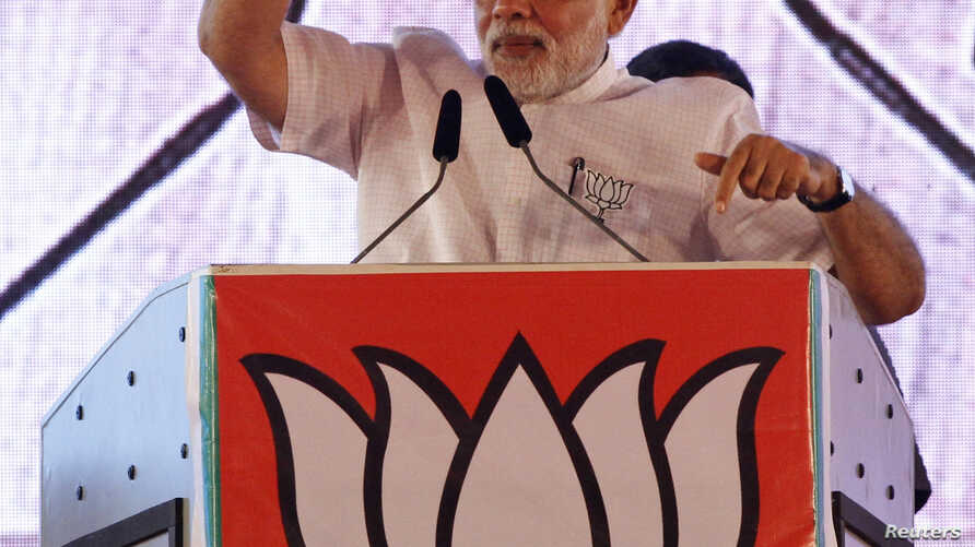 Indian Prime Minister Narendra Modi, campaigning ahead of state assembly elections, speaks at a rally in Mumbai, Oct. 9, 2014.