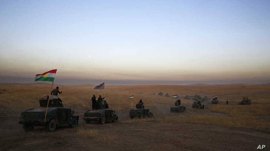 A peshmerga convoy drives toward a frontline in Khazer, about 30 kilometers east of Mosul, Iraq, Oct. 17, 2016.   The Iraqi military and the country's Kurdish forces launched operations to the south and east of militant-held Mosul early Monday mornin...