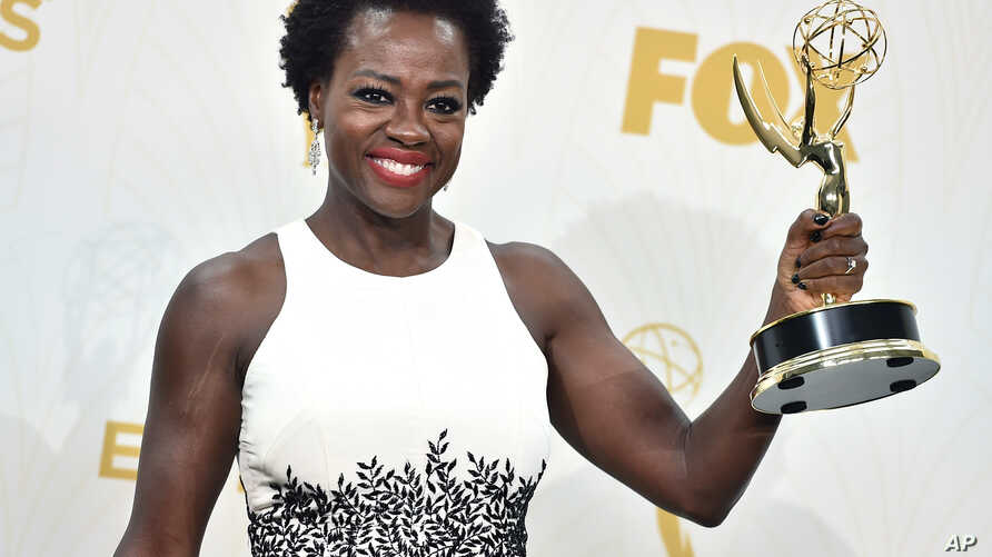 "FILE - Viola Davis poses in the press room with the award for outstanding lead actress in a drama series for ""How to Get Away With Murder"" at the 67th Primetime Emmy Awards in Los Angeles, California, Sept. 20, 2015."