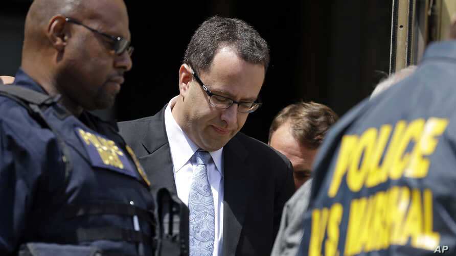 Former Subway pitchman Jared Fogle leaves the Federal Courthouse in Indianapolis, Aug. 19, 2015, following a hearing on child sex and porn charges.