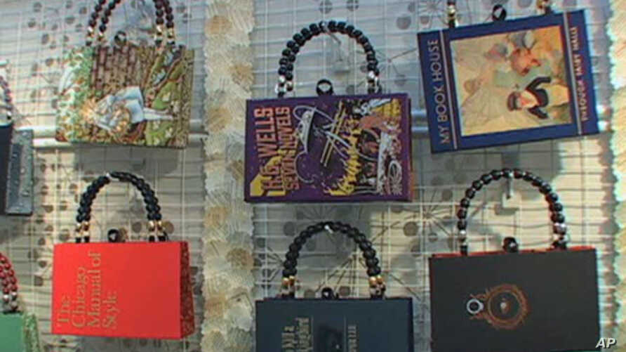 Caitlin Phillips turns discarded books into purses, here on display at the American Craft Council Show in Baltimore, Maryland.
