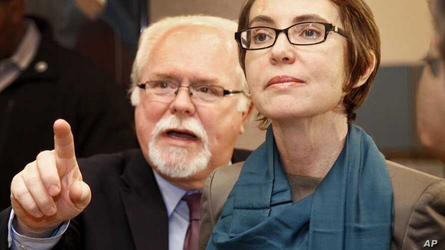 Democrat Ron Barber, a former Giffords aide, seen here with the injured congresswoman in January 2012, hopes to complete the remainder of her term.