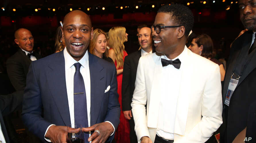 Dave Chappelle, left, and Chris Rock appear backstage at the Oscars, Feb. 28, 2016, at the Dolby Theatre in Los Angeles.
