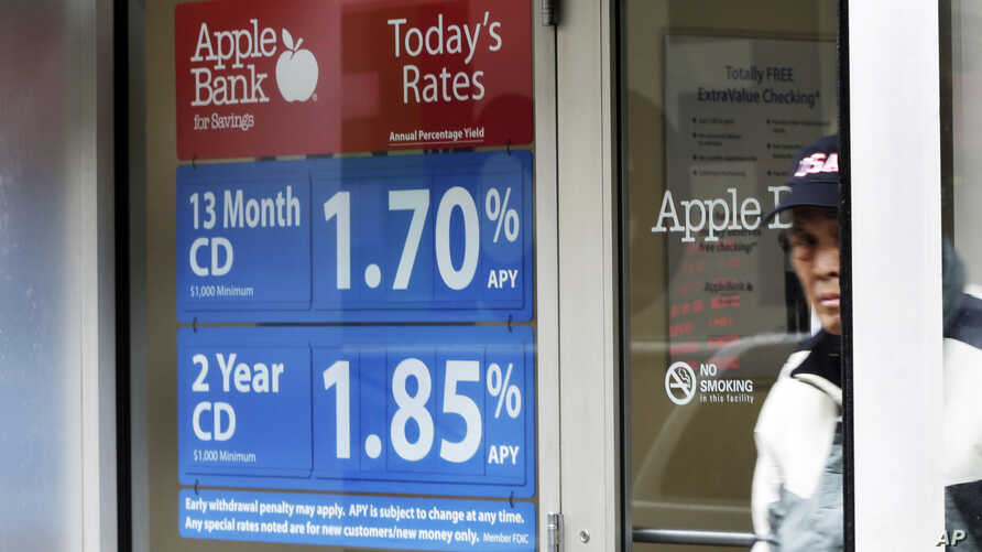 FILE - A sign in the window of the Apple Bank for Savings in New York's Financial District shows CD rates.