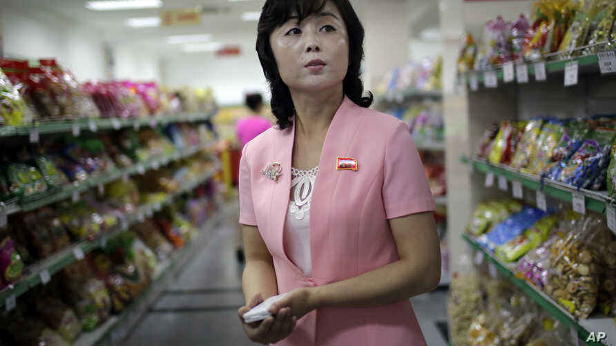 Song Un Pyol, manager at the Potonggang department store stands in the snacks aisle while being interviewed by The Associated Press in Pyongyang, North Korea, June 19, 2017. Three generations into Kim Jong Un's ruling dynasty, markets have blossomed