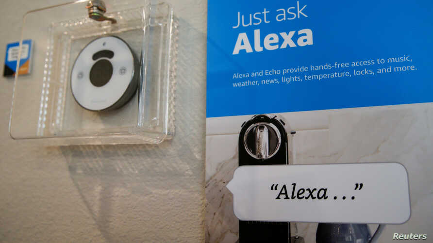 """Prompts on how to use Amazon's Alexa personal assistant are seen in an Amazon """"experience center"""" in Vallejo, California, May 8, 2018."""