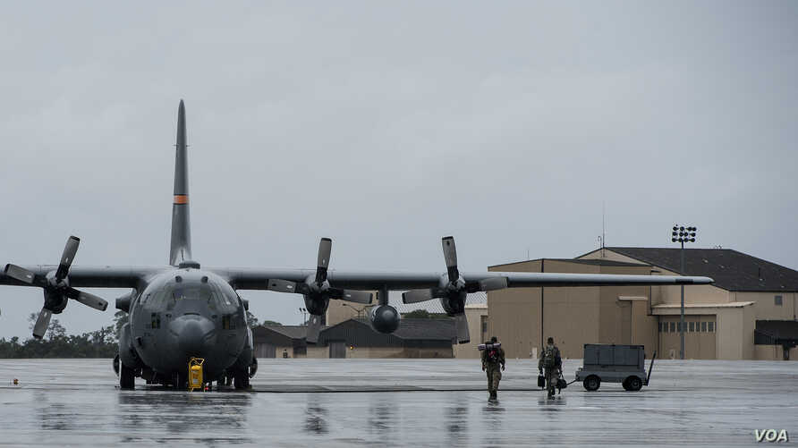 Servicemen from the California National Guard and the Oregon Air National Guard load onto a Texas Air National Guard C-130H Hercules at Hurlburt Field, Florida, Sept. 11, 2017. Supplies, equipment and personnel were transported to the Florida Keys to