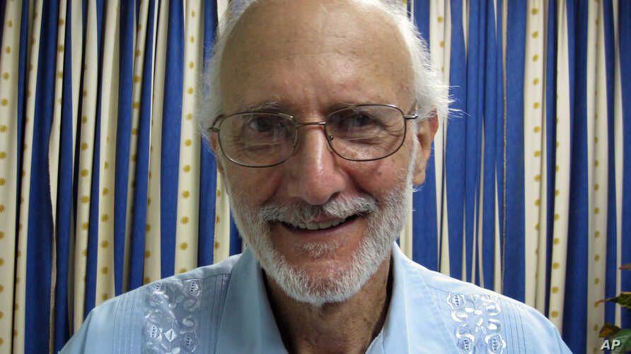 FILE - In this Nov. 27, 2012 file photo provided by James L. Berenthal, shows jailed American Alan Gross poses for a photo during a visit by Rabbi Elie Abadie and U.S. lawyer James L. Berenthal at Finlay military hospital as he serves a prison senten