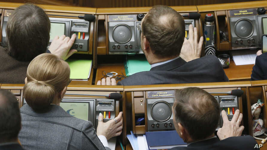 Ukrainian lawmakers vote during a parliament session in Kyiv, Ukraine, Feb. 7, 2019.