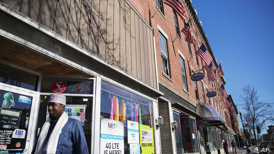 U.S. flags hang outside a downtown building whose storefronts are made up of businesses started by African immigrants who have settled in Lewiston, Maine, March 17, 2017. Maine's immigrants from Sub-Saharan Africa made $136.6 million in income in 201
