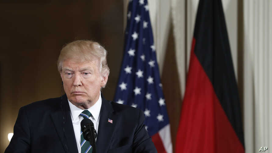 President Donald Trump listens to a question during a joint news conference with German Chancellor Angela Merkel in the East Room of the White House in Washington, March 17, 2017.