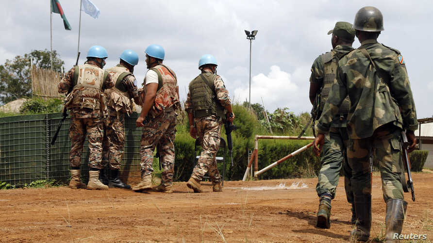 FILE - U.N. peacekeepers and members of the Congolese army in Mavivi, near Beni, North Kivu province, Oct. 22, 2014. Thirty North Korean military instructors may have violated U.N. sanctions by providing pistols to Congolese army and police officers,