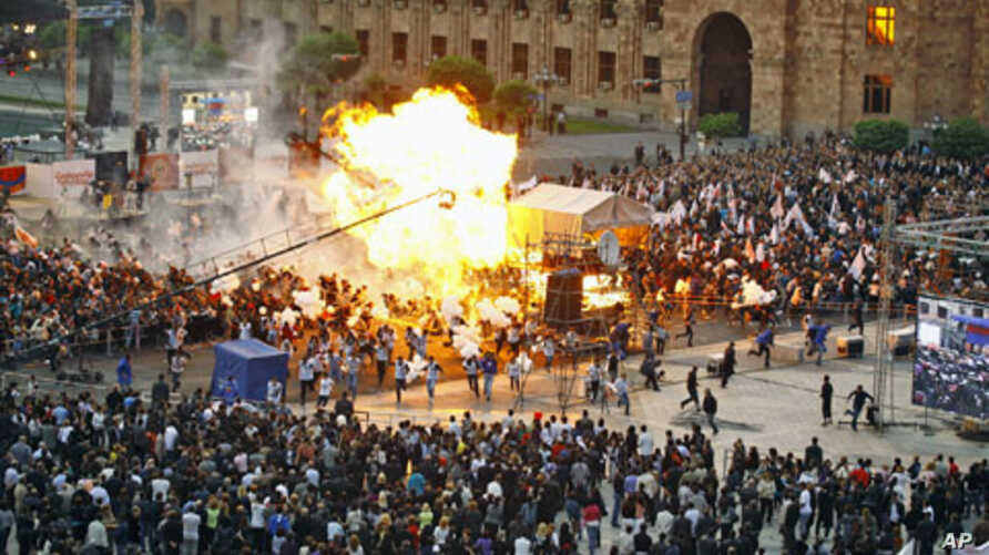Gas-filled balloons explode during a campaign rally concert in the central Republic Square in Yerevan, Armenia, May 4, 2012.