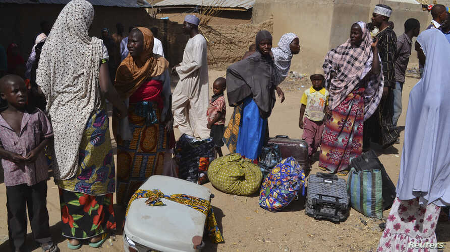 Families from Gwoza, Borno State, displaced by the violence and unrest caused by the insurgency, are seen at a refugee camp in Mararaba Madagali, Adamawa State, Feb. 18, 2014.