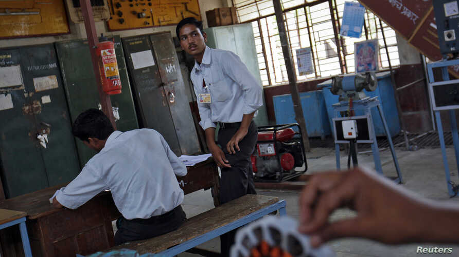 Students work at the electrical department of the Industrial Training Institute in Beed, about 350 km (220 miles) east of Mumbai, June 28, 2012. India says the voice urging the 10 militants on to bloodshed during the assault on Mumbai in November 200