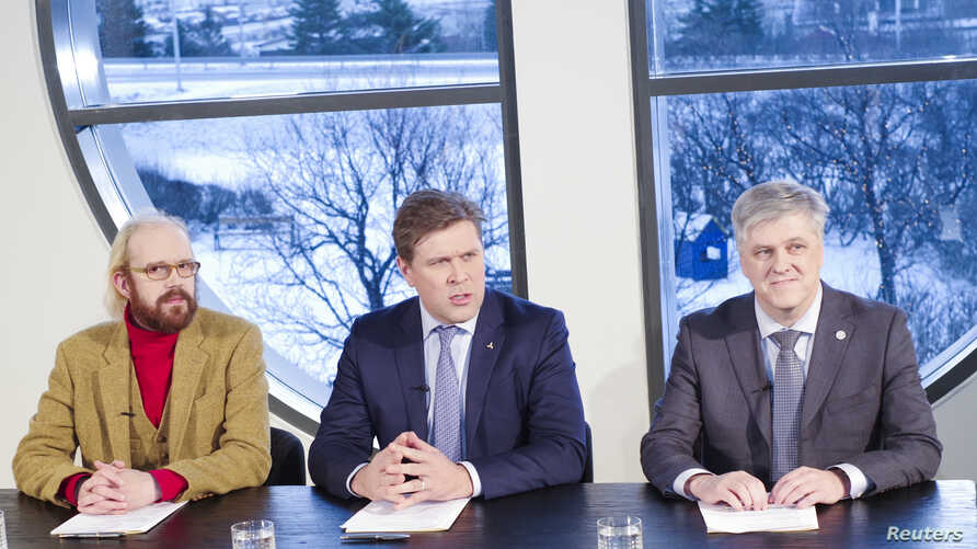 Bjarni Benediktsson the leader of the Icelandic Independence Party, a member of the parliament Ottarr Proppe and politican Benedikt Johannesson introducing the new Icelandic government agreement during a press conference in Kopavogur, Iceland, Jan. 1