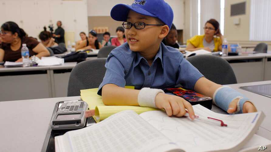 Moshe Kai Cavalin, 10, takes statistics college classes at the East Los Angeles College in Los Angeles, Calif.