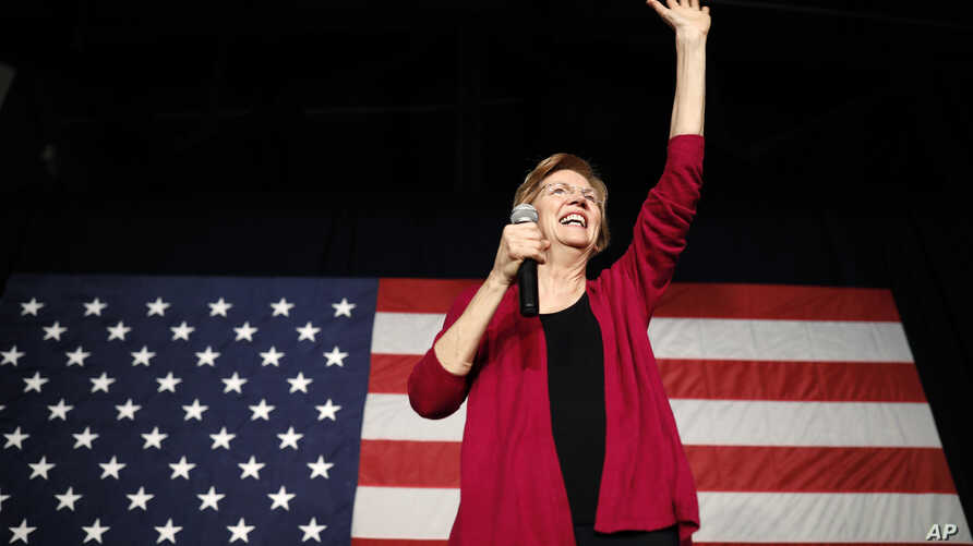 Sen. Elizabeth Warren, D-Mass, waves to the crowd during an organizing event at Curate event space in Des Moines, Iowa, Jan. 5, 2019.