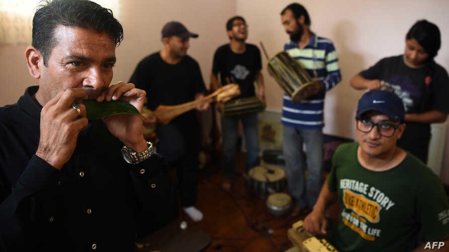 Nepali band Night gathers for a rehearsal during an interview with AFP in Kathmandu, Sept. 18, 2017. Nepal's musical heritage is enjoying a revival as young musicians fuse the sounds of traditional instruments once at risk of disappearing with lyrics