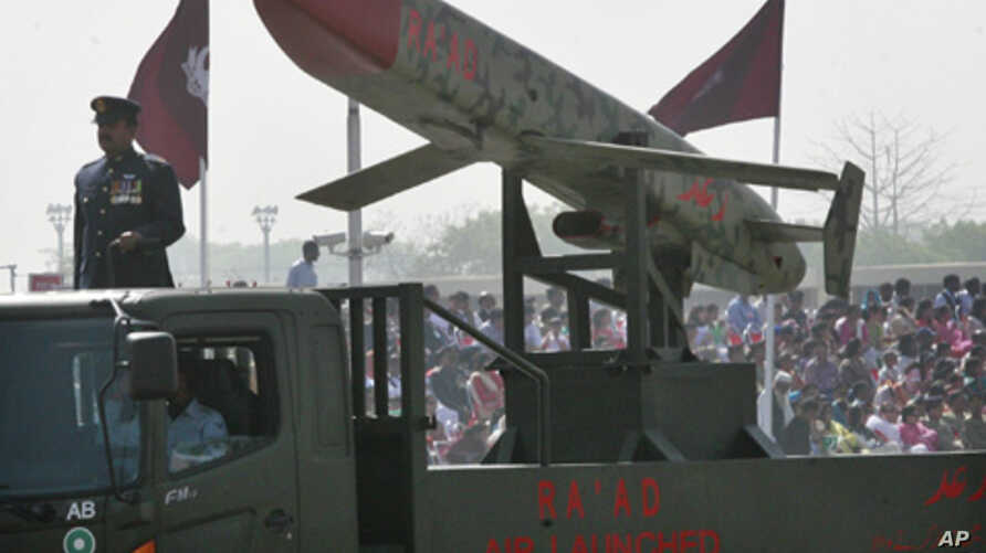 """Pakistan's nuclear-capable air-launched """"Ra'ad"""" cruise missile is driven past crowds during the National Day military parade in Islamabad, March 23, 2008"""