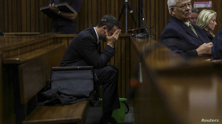 Olympic and Paralympic track star Oscar Pistorius listens during testimony at the North Gauteng High Court in Pretoria, South Africa, March 11, 2014.