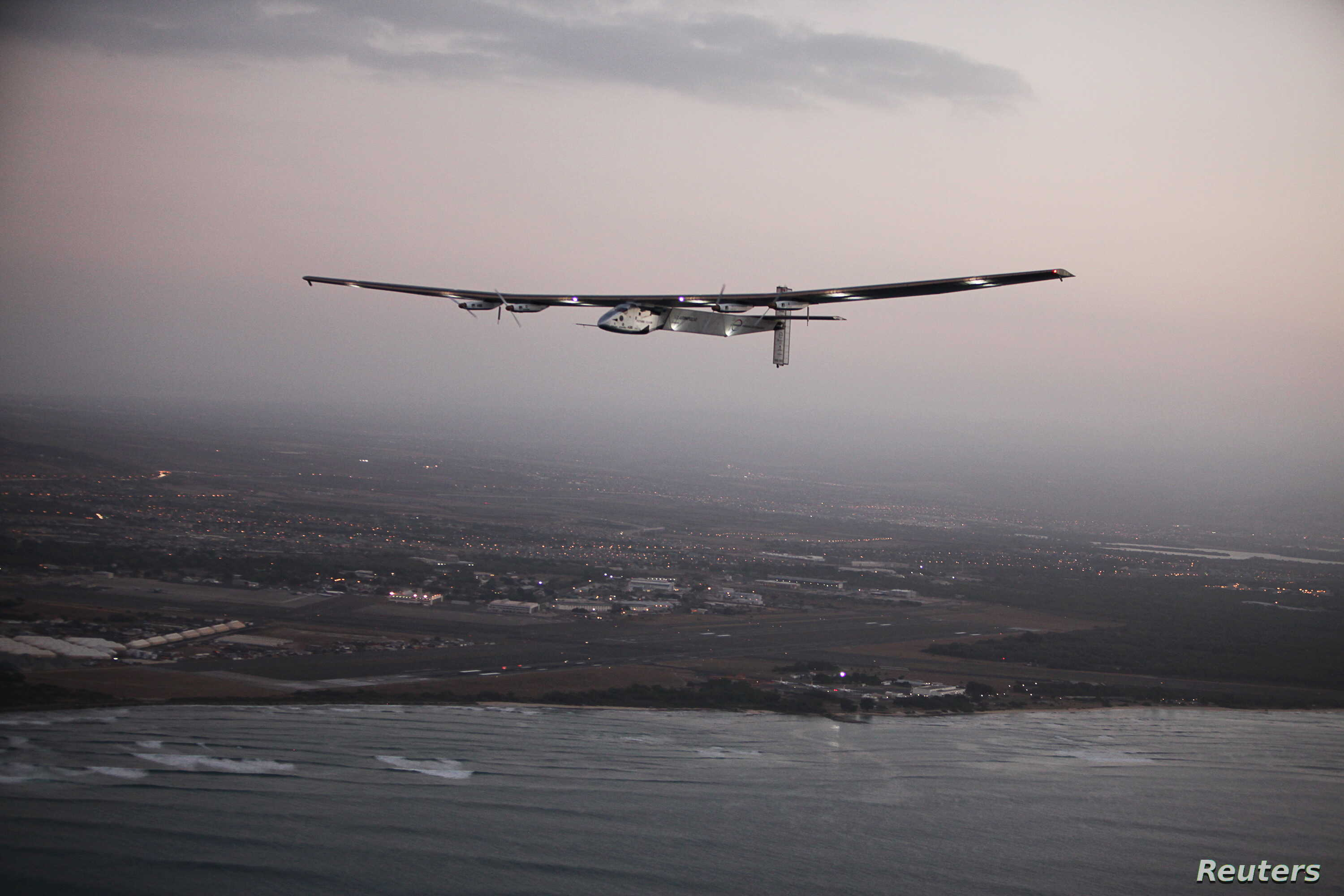The Solar Impulse 2 airplane, flown by test pilot Markus Scherdel, flies off the coast of Oahu during a test flight from Kalaealoa Airfield in Kapolei, Hawaii, March 3, 2016.