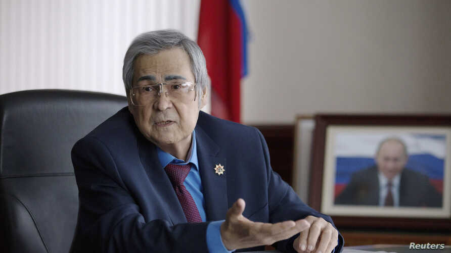 FILE - Governor of the Kemerovo region, Aman Tuleyev, speaks during a meeting in Kemerovo, Russia, March 7, 2018 Tuleyev announced his resignation Sunday.