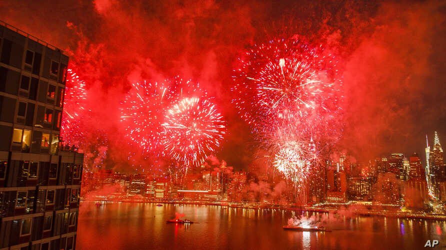 With the New York City skyline in the background, fireworks explode during an Independence Day show over the East River, Wednesday, July 4, 2018, in New York.
