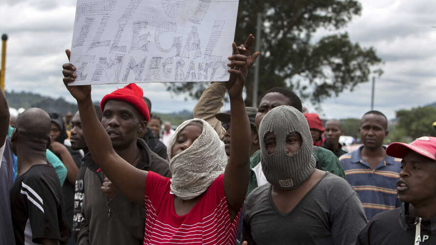 South Africans wave anti-immigration placards during a protest in Pretoria, South Africa, Feb. 24, 2017.