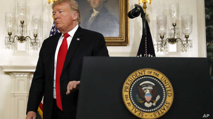 President Donald Trump leaves the podium after speaking about the partial government shutdown, immigration and border security in the Diplomatic Reception Room of the White House in Washington, Jan. 19, 2019.