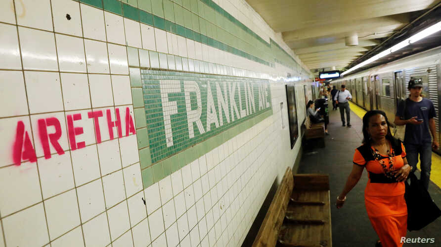 """""""Aretha"""" is spray painted next to a sign at the Franklin Street subway station, in memory of singer Aretha Franklin, in the Brooklyn borough of New York, Aug. 16, 2018."""