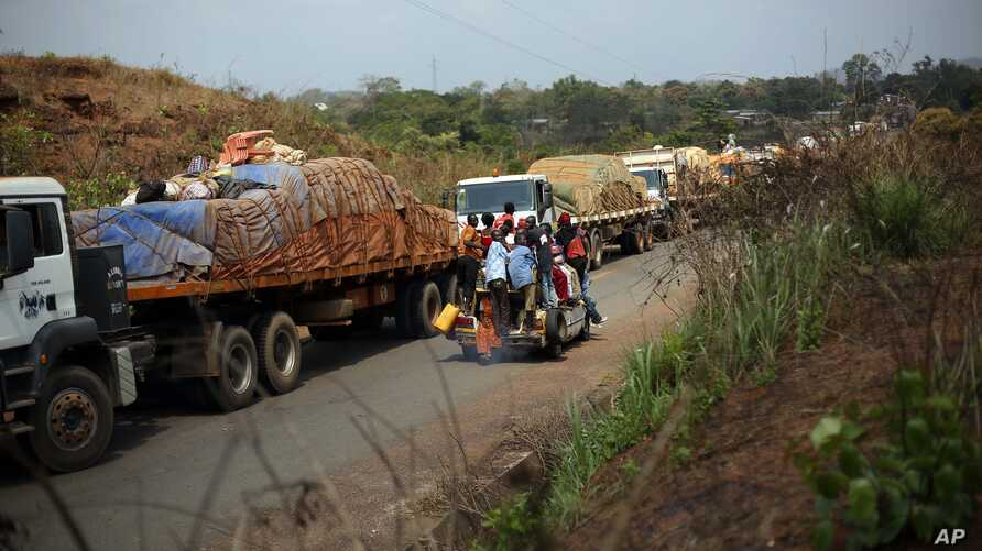 FILE - A convoy of over 100 trucks arriving in the Central African Republic capital, Bangui, from Cameroon.